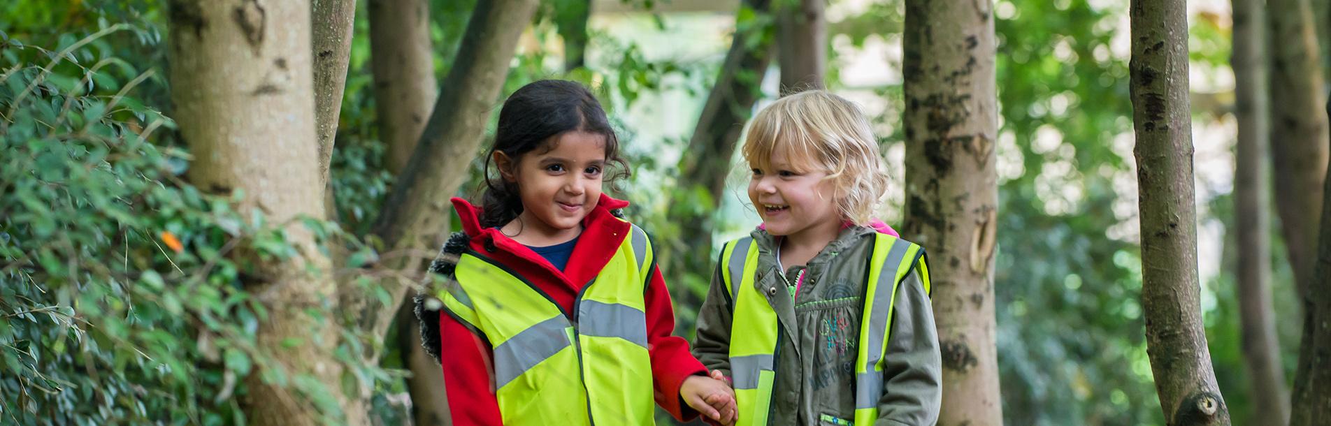 Two children walking in the garden